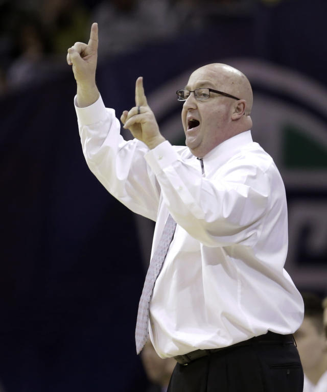 Western Michigan head coach Steve Hawkins yells to teammates during the second half of an NCAA college basketball game against Akron at the Mid-American Conference tournament Friday, March 14, 2014, in Cleveland. Western Michigan defeated Akron 64-60 in overtime. (AP Photo/Tony Dejak)