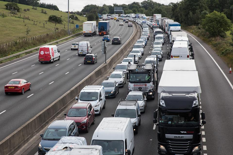 Traffic is queued on the M25 after climate activists from Insulate Britain block a slip road as part of a new campaign intended to push the UK government to make significant legislative change to start lowering emissions on 13th September 2021 in Godstone, United Kingdom. The activists, who wrote to Prime Minister Boris Johnson on 13th August, are demanding that the government immediately promises both to fully fund and ensure the insulation of all social housing in Britain by 2025 and to produce within four months a legally binding national plan to fully fund and ensure the full low-energy and low-carbon whole-house retrofit, with no externalised costs, of all homes in Britain by 2030 as part of a just transition to full decarbonisation of all parts of society and the economy. (photo by Mark Kerrison/In Pictures via Getty Images)