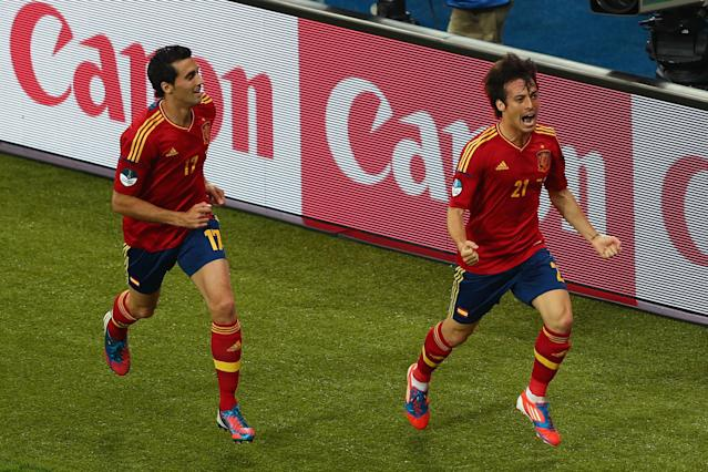 KIEV, UKRAINE - JULY 01: David Silva (R) of Spain celebrates with his team-mate Alvaro Arbeloa after scoring the opening goal during the UEFA EURO 2012 final match between Spain and Italy at the Olympic Stadium on July 1, 2012 in Kiev, Ukraine. (Photo by Michael Steele/Getty Images)