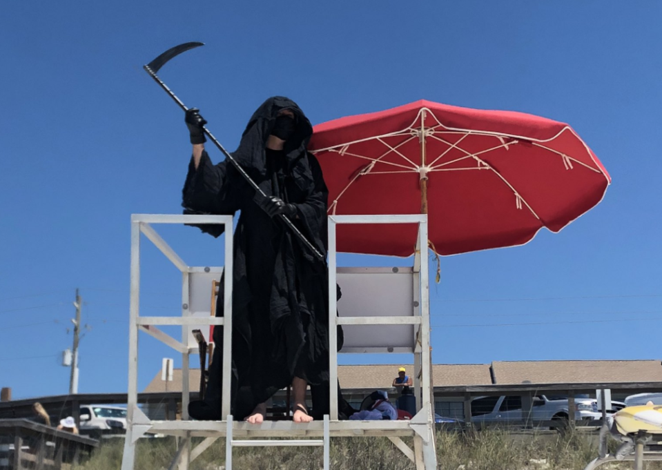 A Florida attorney is touring re-opened beaches as the Grim Reaper. (Photo: Twitter)