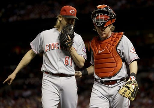 Cincinnati Reds starting pitcher Bronson Arroyo, left, and catcher Ryan Hanigan walk off the field after working the second inning of a baseball game against the St. Louis Cardinals, Monday, Oct. 1, 2012, in St. Louis. (AP Photo/Jeff Roberson)