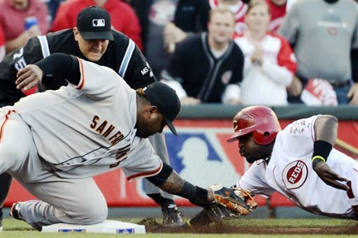 San Francisco Giants third baseman Pablo Sandoval tags out Cincinnati Reds' Brandon Phillips at third base in the first inning during Game 3 of the National League division baseball series, Tuesday, Oct. 9, 2012, in Cincinnati. (AP Photo/Michael Keating)