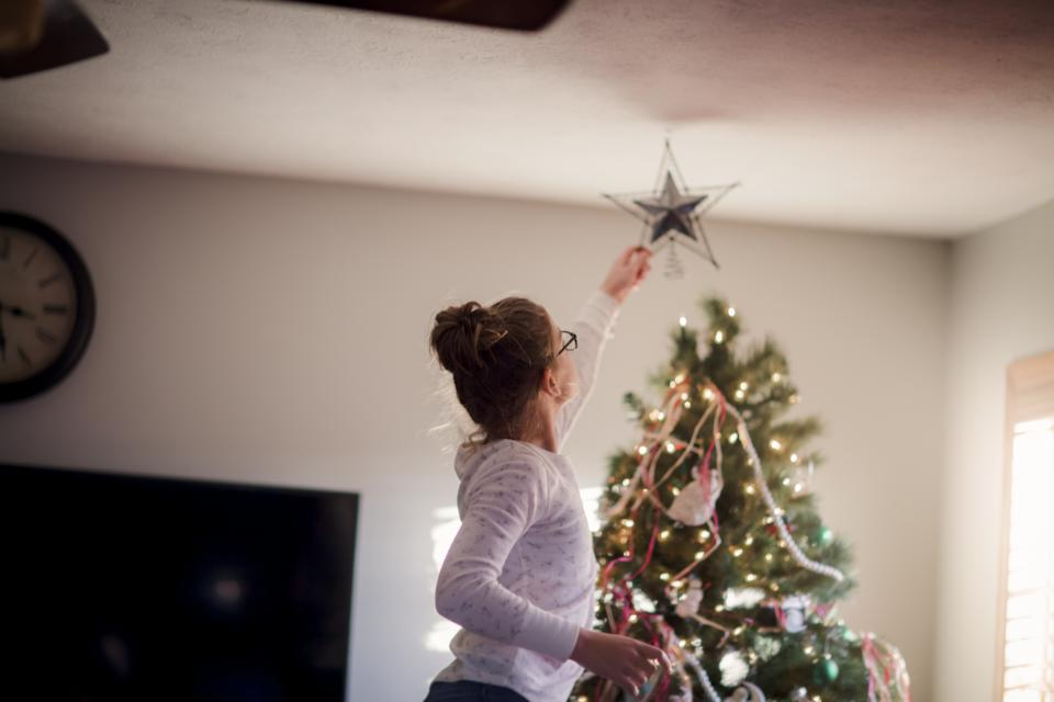People are already putting up their Christmas trees this year. (posed by model, Getty Images)