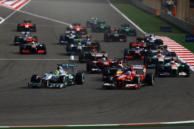 SAKHIR, BAHRAIN - APRIL 21: Nico Rosberg (front left) of Germany and Mercedes GP leads the field into the first corner at the start of the Bahrain Formula One Grand Prix at the Bahrain International Circuit on April 21, 2013 in Sakhir, Bahrain. (Photo by Vladimir Rys/Getty Images)