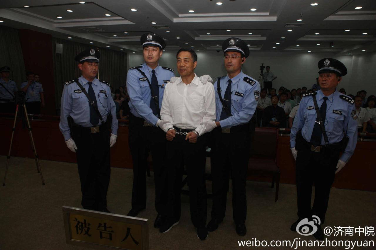 Ousted Chinese politician Bo Xilai is handcuffed after the announcement of his verdict inside the court in Jinan