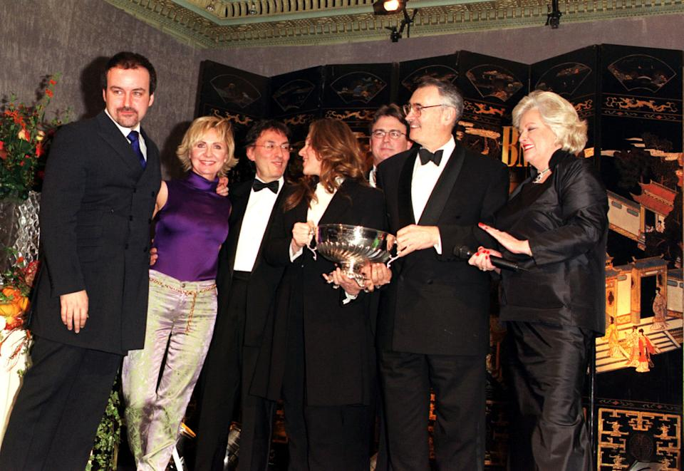 Composer David Arnold (L), Singer Lulu (2nd L) and Barbara Brocolli (R) at the Dorchester Hotel, London,  for the BMI London Awards. The awards are given to the songs that have received the most radio and TV airplay in the United States.   (Photo by Michael Crabtree - PA Images/PA Images via Getty Images)