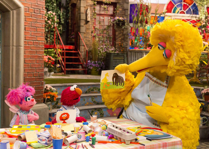 """This image released by HBO shows characters, from left, Abby Cadabby, Elmo and Big Bird in a scene from """"Sesame Street."""" The popular children's TV show is celebrating its 50th season. (HBO via AP)"""