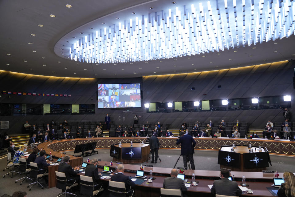 NATO Secretary General Jens Stoltenberg, left, speaks in the main chamber during a NATO Foreign Ministers video meeting following developments in Afghanistan at the NATO headquarters in Brussels, Friday, Aug. 20, 2021. (AP Photo/Francisco Seco, Pool)