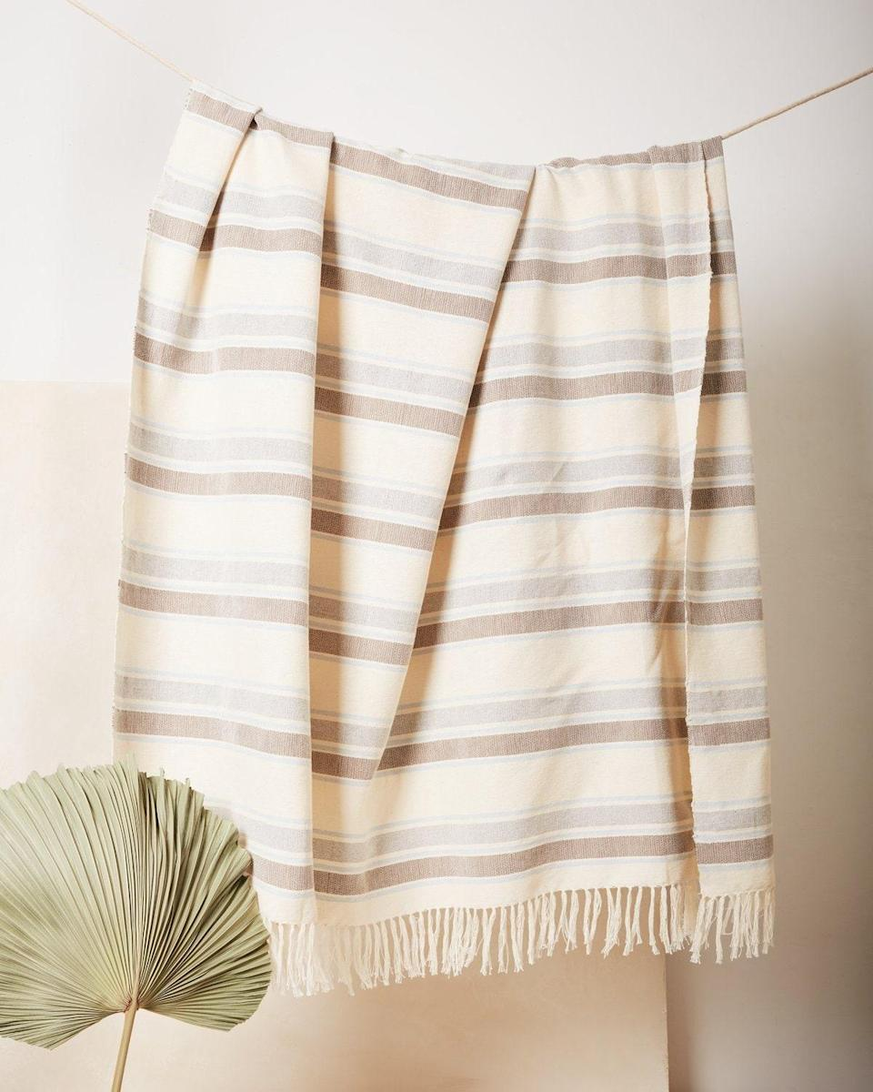 """Treat your friends to a cozy throw blanket for their new couch. Minna's pieces are all sustainably sourced and made in partnership with artisans from around the world. $150, Minna. <a href=""""https://www.minna-goods.com/collections/blankets-throws/products/sky-stripe-throw"""" rel=""""nofollow noopener"""" target=""""_blank"""" data-ylk=""""slk:Get it now!"""" class=""""link rapid-noclick-resp"""">Get it now!</a>"""