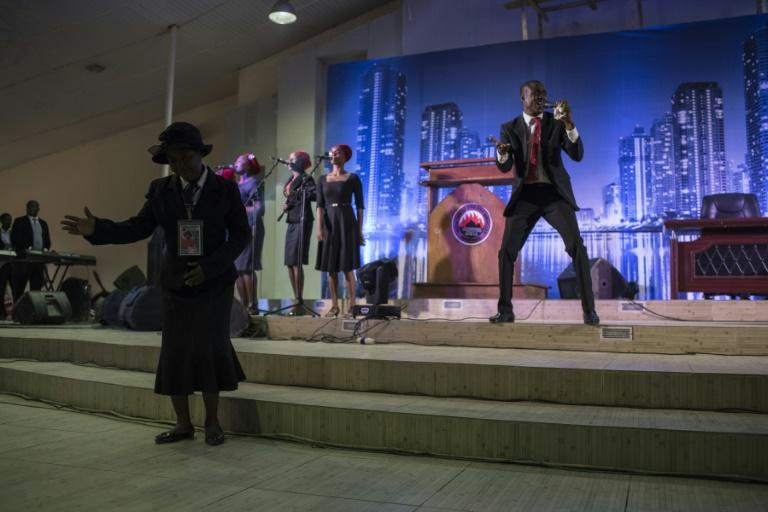 "A singer leads prayers at a ""singles summit,"" one of several at Pentecostal churches in Nigeria promising to teach how to pick the right partner and avoid pitfalls"