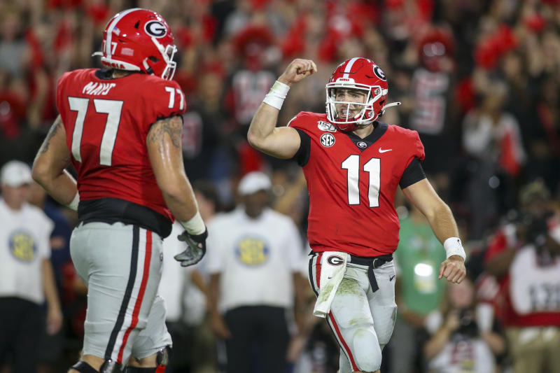 Sep 21, 2019; Athens, GA, USA; Georgia Bulldogs quarterback Jake Fromm (11) celebrates with offensive tackle Cade Mays (77) after a touchdown against the Notre Dame Fighting Irish in the second quarter at Sanford Stadium. Mandatory Credit: Brett Davis-USA TODAY Sports