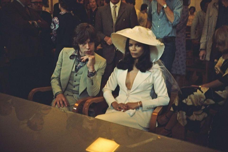 """<p>Rock's glamour couple, Rolling Stone frontman Mick Jagger <a href=""""http://www.rollingstone.com/music/news/mick-jagger-rocks-his-own-wedding-reception-in-st-tropez-19710610"""" rel=""""nofollow noopener"""" target=""""_blank"""" data-ylk=""""slk:married Bianca"""" class=""""link rapid-noclick-resp"""">married Bianca</a> Pérez-Mora Macias in 1971 when she was already four months pregnant. They were married in a Roman Catholic ceremony and word got out about the wedding, leading over 100 photographers and reporters to swarm the scene. They had one child together named Jade, and Bianca filed for divorce in 1978, reportedly because Jagger had been unfaithful. <br></p>"""
