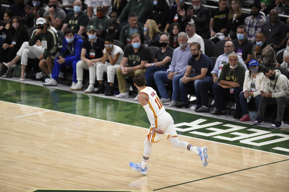 Hawks guard Trae Young celebrates a basket against the Bucks in Game 1 of the Eastern Conference finals. (Patrick McDermott/Getty Images)