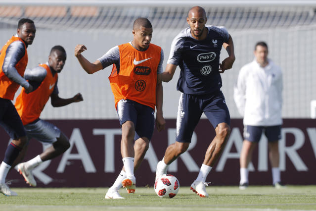 France's Kylian Mbappe controls the ball ahead of Stve Nzonzi during a training session at the 2018 soccer World Cup in Glebovets, Russia, Monday, July 2, 2018. (AP Photo/David Vincent)