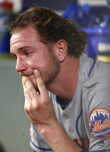 New York Mets relief pitcher Drew Gagnon sits on the bench after being replaced in the eighth inning of a baseball game against the Atlanta Braves, Monday, June 17, 2019, in Atlanta. (AP Photo/John Bazemore)