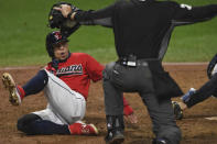 Cleveland Indians' Cesar Hernandez reacts after being called safe at home during the fifth inning of Game 2 of the team's American League wild-card baseball series against the New York Yankees, Wednesday, Sept. 30, 2020, in Cleveland. (AP Photo/David Dermer)