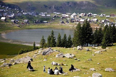 Tourists from the Middle East enjoy along the Prokosko Lake near Fojnica, Bosnia and Herzegovina, August 20, 2016. REUTERS/Dado Ruvic
