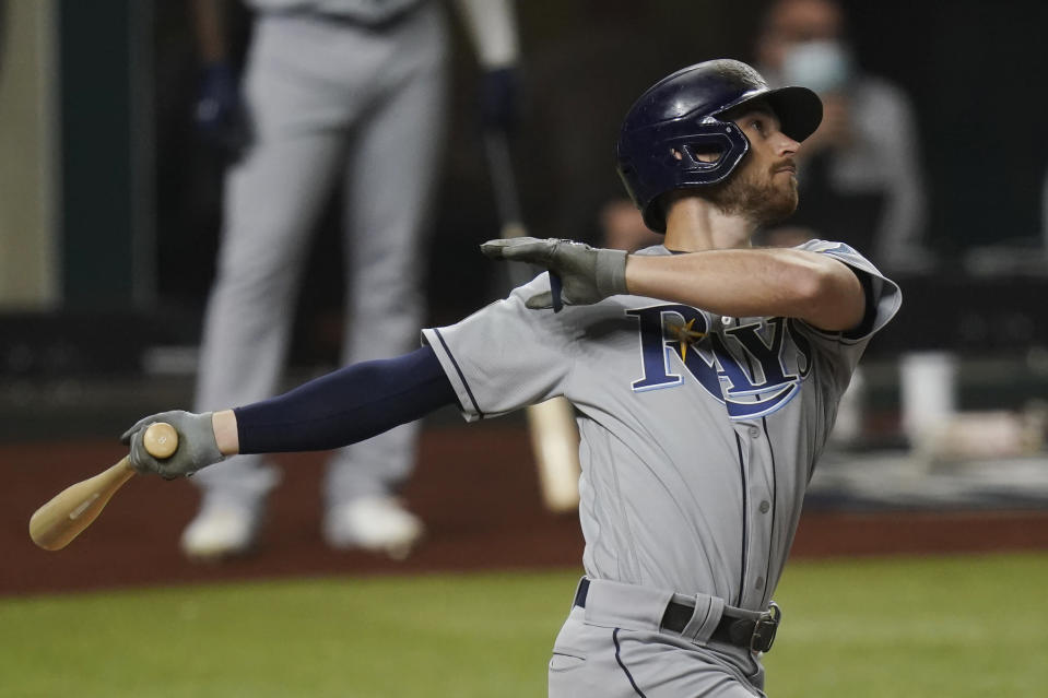 Tampa Bay Rays' Brandon Lowe hits a home run against the Los Angeles Dodgers during the first inning in Game 2 of the baseball World Series Wednesday, Oct. 21, 2020, in Arlington, Texas. (AP Photo/Eric Gay)
