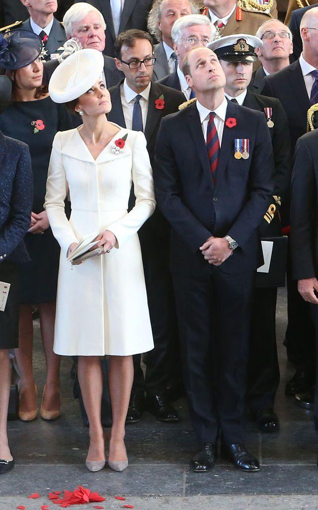 """<p>For the 100th anniversary of the Battle of Passchendaele, Duchess Kate recycled a flawless white Alexander McQueen dress with matching white fascinator. The royal wore the same dress to <a href=""""https://www.townandcountrymag.com/society/tradition/a3392/princess-charlotte-mario-testino-photos/"""" rel=""""nofollow noopener"""" target=""""_blank"""" data-ylk=""""slk:Charlotte's christening"""" class=""""link rapid-noclick-resp"""">Charlotte's christening</a> two years earlier. </p>"""