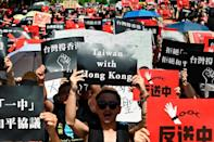Demonstrators rallied in Taiwan -- including in this march in Taipei in mid-June -- to show their support for the Hong Kong protesters (AFP Photo/Sam YEH)