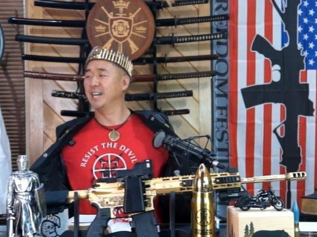 """<p>Hyung Jin """"Sean"""" Moon, the leader of Sanctuary Church and Rod of Iron Ministries, delivers his """"King's Report"""" sermon from behind  a golden AR-15</p> (Twitch screengrab)"""