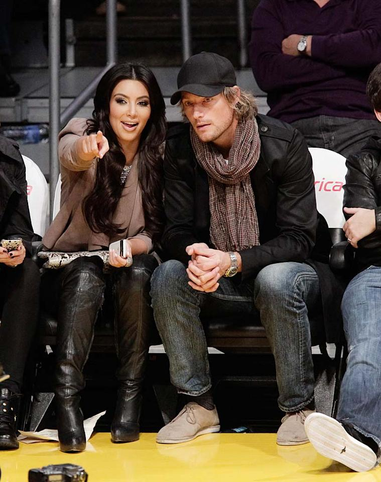"""Reality queen Kim Kardashian got up close and personal with Halle Berry's ex-baby daddy Gabriel Aubry at a Los Angeles Lakers game this week. A pal of Kim's told UsMagazine.com, """"They met through friends and have been dating a few weeks. It's sexy!"""" Added the insider, """"They decided to step out together at the game."""" Noel Vasquez/<a href=""""http://www.gettyimages.com/"""" target=""""new"""">GettyImages.com</a> - November 21, 2010"""