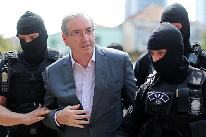 Brazil's former President of the Chamber of Deputies Eduardo Cunha, arrives at the Forensic Medicine Institute in Curitiba, on October 20, 2016 (AFP Photo/Heuler Andrey)