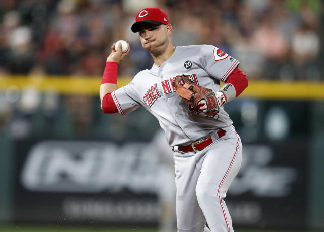 Cincinnati Reds shortstop Jose Iglesias throws to first base to put out Colorado Rockies' Charlie Blackmon during the second inning of a baseball game Saturday, July 13, 2019, in Denver. (AP Photo/David Zalubowski)
