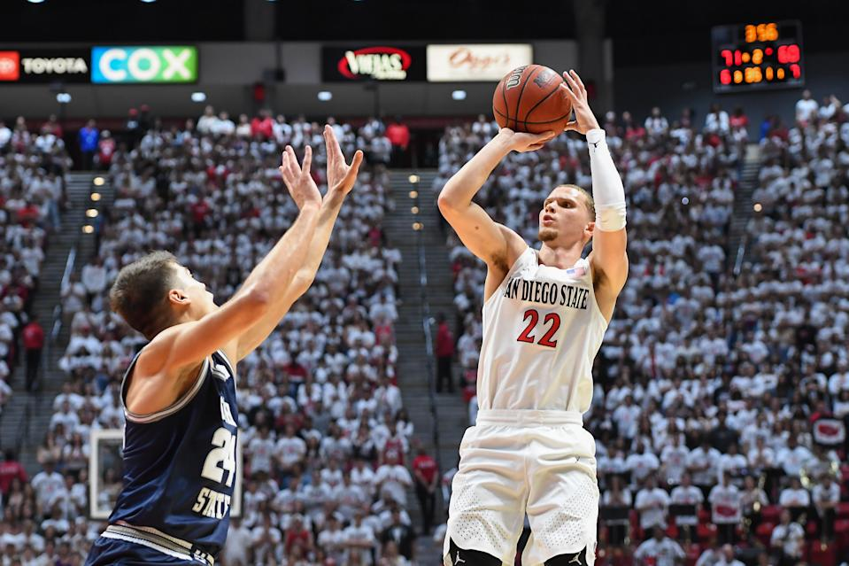 San Diego State Aztecs guard Malachi Flynn (22) shoots the ball during a college basketball game between Utah State and SDSU on Feb. 1. (Justin Fine/Icon Sportswire via Getty Images)