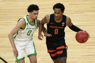 Oregon State's Gianni Hunt drives into Oregon's Will Richardson during the first half of an NCAA college basketball game in the semifinal round of the Pac-12 men's tournament Friday, March 12, 2021, in Las Vegas. (AP Photo/John Locher)