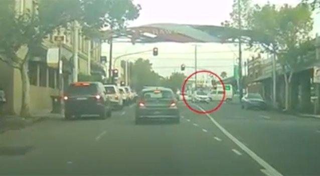 The cyclist manages to land safely on the roof in remarkable footage. Photo: Newsflare/ Dracothian