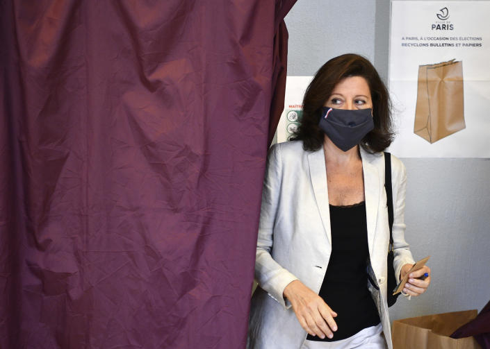Agnes Buzyn, candidate for the presidential party La Republique en Marche (LREM) in the second round of municipal elections, leaves the voting booth before voting Sunday, June 28, 2020 in Paris. France is holding the second round of municipal elections in 5,000 towns and cities Sunday that got postponed due to the country's coronavirus outbreak. (Christophe Archambault, Pool via AP)