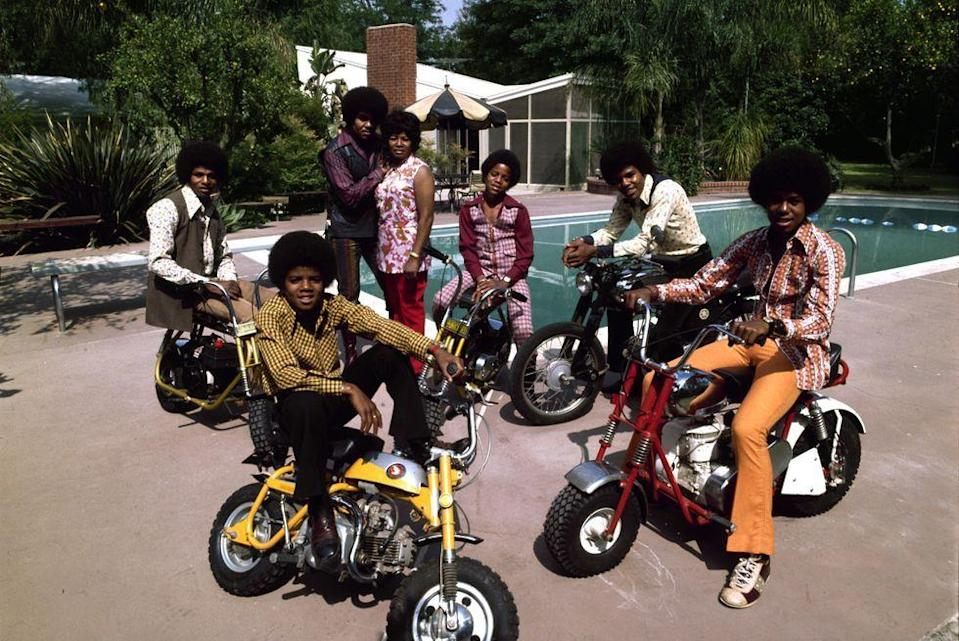 <p>The Jackson 5 pose with minibikes and their parents at their pool in Encino, California in 1971. </p>