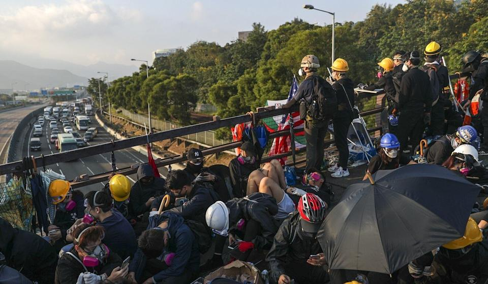 Students protesting at Chinese University throw obstacles onto the Tolo Highway in Sha Tin. Photo: Sam Tsang