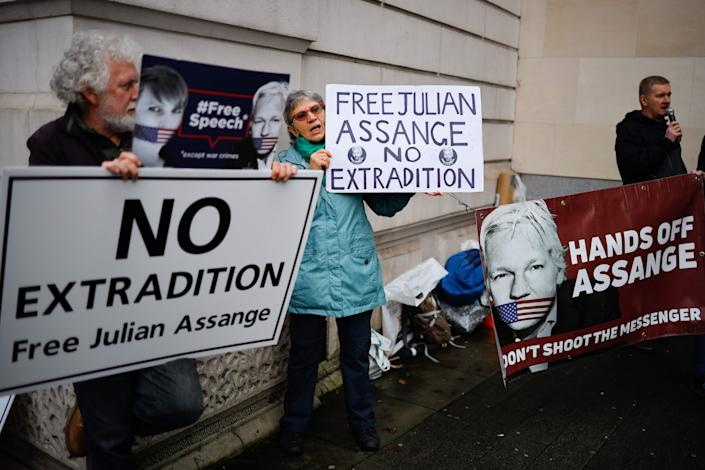 Supporters of WikiLeaks founder Julian Assange hold placards outside Westminster Magistrates Court in London on December 19, 2019.