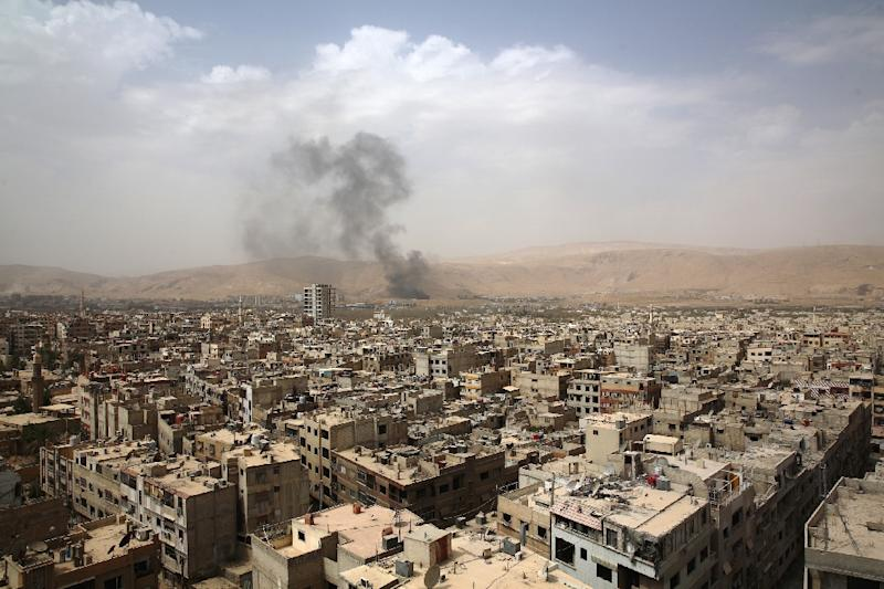 A picture taken on September 14, 2015 shows smoke billowing from the Syrian rebel-held area of Douma, east of the capital Damascus, following a reported air strike by Syrian government forces (AFP Photo/Abd Doumany)
