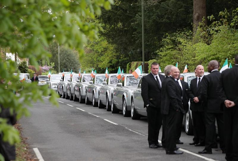 Mourners arrive for the funeral of Simon Doherty in Surrey(PA)