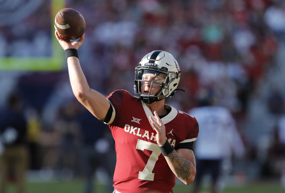 Oklahoma quarterback Spencer Rattler (7) warms up before the start of a game against West Virginia in Norman, Okla., Saturday, Sep. 25, 2021. (AP Photo/Alonzo Adams)