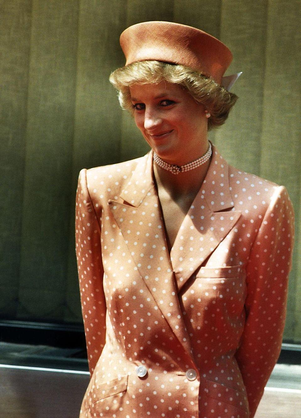 <p>The royal opted for a tan and cream color scheme when attending a state visit. </p>