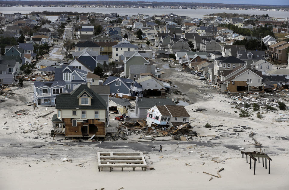This aerial photo shows destruction in the wake of superstorm Sandy on Wednesday, Oct. 31, 2012, in Seaside Heights, N.J. (AP Photo/Mike Groll)