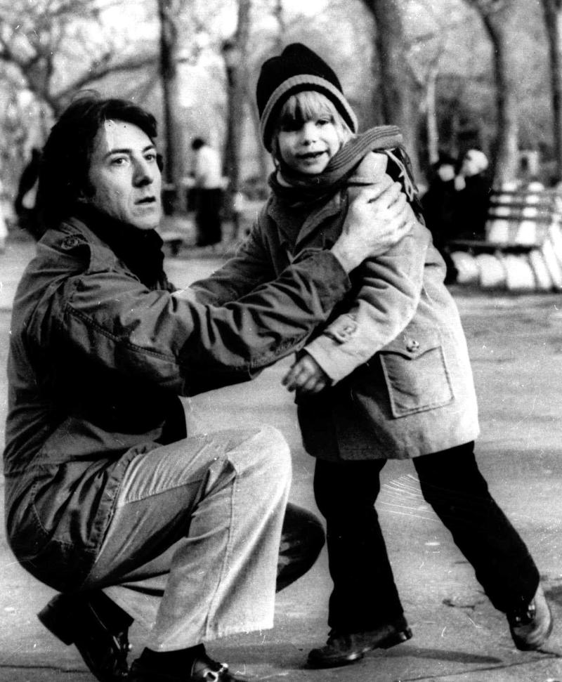 """FILE - In this 1979 publicity file photo, Dustin Hoffman, left, and Justin Henry appear in the film, """"Kramer vs. Kramer."""" Henry was just 6 years old and had never acted when a casting director came to his Rye, N.Y., school looking for someone to play Billy, the little boy at the center of Dustin Hoffman and Meryl Streep's custody battle. He was 7 when he shot the film and 8 when he was nominated for best supporting actor. (AP Photo, File)"""