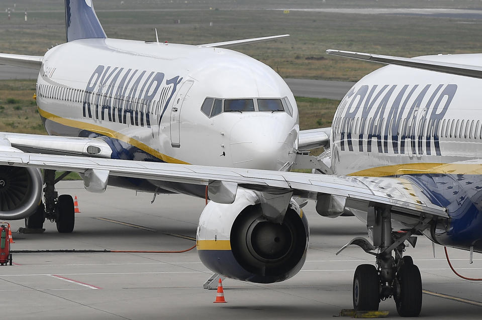 FILE - In this file photo dated Wednesday, Sept. 12, 2018, Ryanair aircraft stand at the airport in Weeze, Germany.  Europe's busiest airline, budget carrier Ryanair, said in a statement Wednesday Dec. 4, 2019, it is closing bases at Nuremberg in Germany, and Stockholm in Sweden, because of delays to deliveries of Boeing 737 Max airplanes, which have been grounded for months over security concerns. (AP Photo/Martin Meissner, FILE)