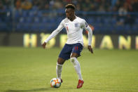 England's Callum Hudson-Odoi dribbles with the ball in his first match for the team during the Euro 2020 group A qualifying soccer match between Montenegro and England at the City Stadium in Podgorica, Montenegro, Monday, March 25, 2019. (AP Photo/Darko Vojinovic)