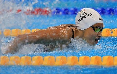 Yusra Mardini of the Refugee Olympic Athletes competes in the women's 100m butterfly. REUTERS/Dominic Ebenbichler