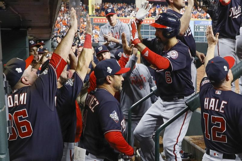 Washington Nationals' Anthony Rendon is congratulated after hitting a two-run home run during the seventh inning of Game 6 of the baseball World Series against the Houston Astros Tuesday, Oct. 29, 2019, in Houston. (AP Photo/Matt Slocum)