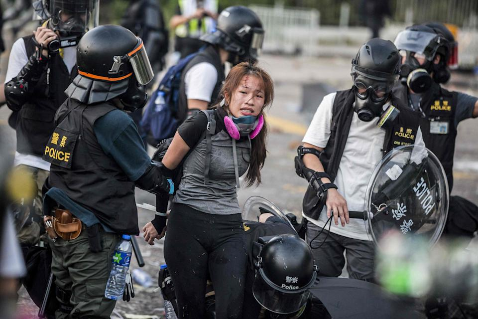 <p>Police detain demonstrators in the Sha Tin district of Hong Kong in 2019</p> (AFP/Getty Images)