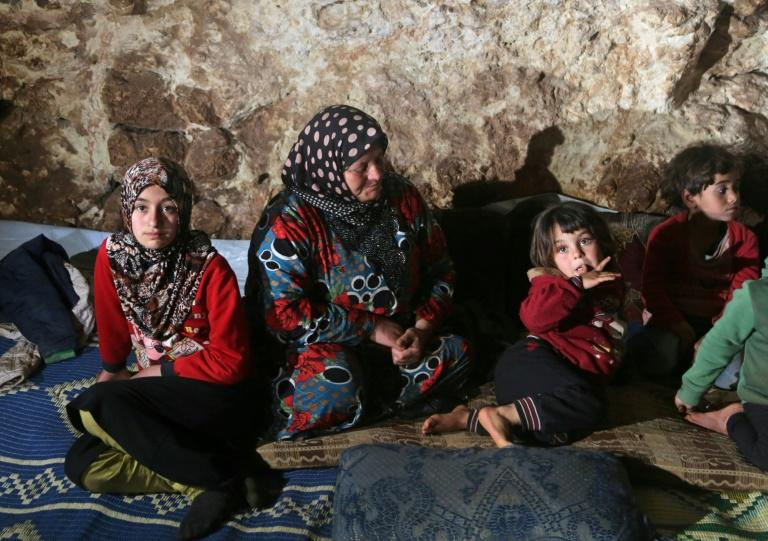 Civilians fleeing the Syrian government's offensive on the country's last rebel bastion have been forced to find shelter where they can -- in caves, abandoned buildings and even a cemetery (AFP Photo/Aref TAMMAWI)