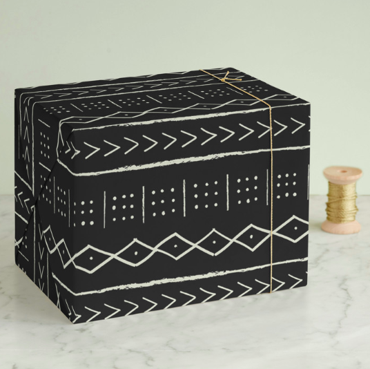 """<strong><h3><a href=""""https://www.minted.com/wrapping-paper"""" rel=""""nofollow noopener"""" target=""""_blank"""" data-ylk=""""slk:Minted"""" class=""""link rapid-noclick-resp"""">Minted</a></h3></strong><br><strong>Good for: </strong>Stocking up during sale season for future gift-giving opportunities. It's not as affordable as other retailers, but these designs are unique enough to be worthy of a splurge. <br><br><strong>What to love: </strong>We love the bespoke vibe of these stylish designs — most tend to err on the side of minimalist while still feeling like a festive statement wrap. <br><br><strong>Erin Deegan</strong> Mud Cloth Tribe Wrapping Paper, $, available at <a href=""""https://go.skimresources.com/?id=30283X879131&url=https%3A%2F%2Fwww.minted.com%2Fproduct%2Fwrapping-paper%2FMIN-Y26-NWR%2Fmud-cloth-tribe"""" rel=""""nofollow noopener"""" target=""""_blank"""" data-ylk=""""slk:Minted"""" class=""""link rapid-noclick-resp"""">Minted</a>"""
