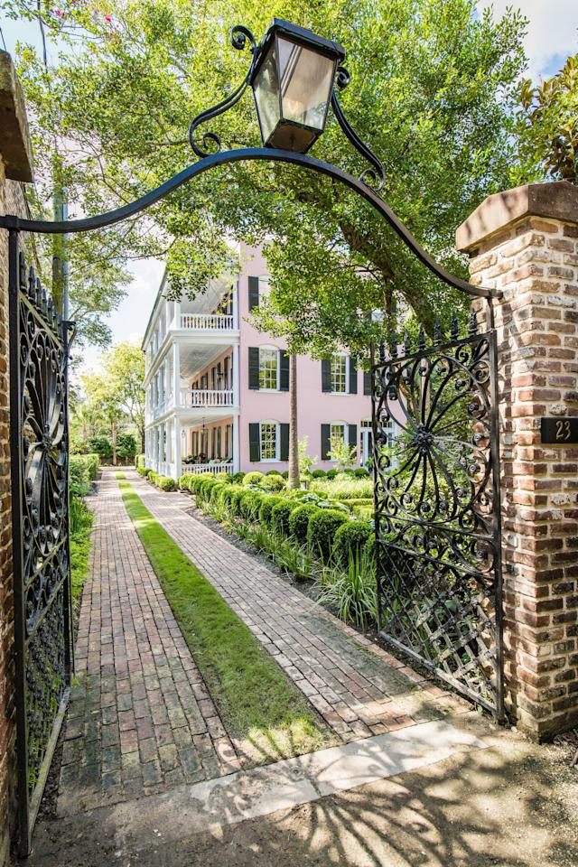<p>To access the grounds, you'll follow a private drive to the wrought-iron gate that will lead you to the ½-acre estate. </p>