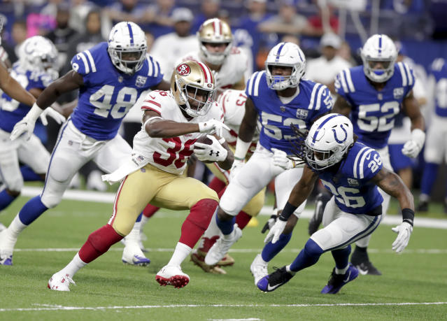 San Francisco 49ers running back Alfred Morris (36) outruns the defense of Indianapolis Colts linebacker Skai Moore (48), linebacker Darius Leonard (53), and defensive back Clayton Geathers (26) during the first half of an NFL preseason football game in Indianapolis, Saturday, Aug. 25, 2018. (AP Photo/Michael Conroy)